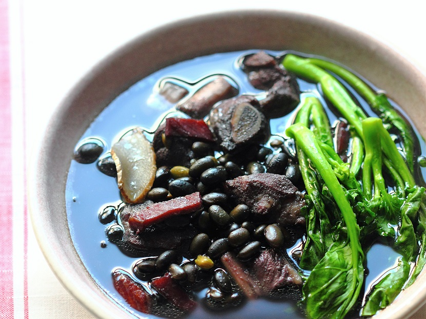 Black soybean soup with pork ribs, ham, and gai lan